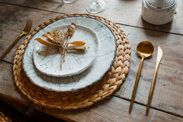White plate and golden fork with a spoon