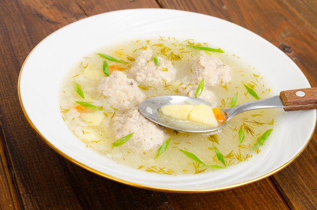 White plate of meatball soup