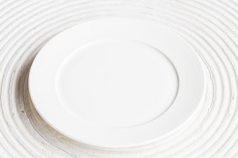 White plate on white wood background