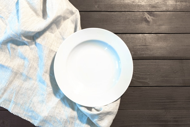 White plate on a tablecloth