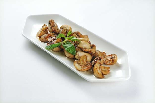 White plate with grilled mushrooms