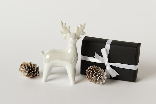 White porcelain reindeer with a present