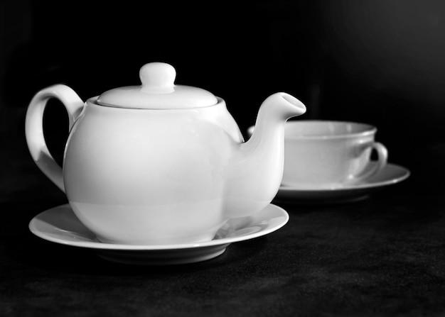 White porcelain tea cup and teapot