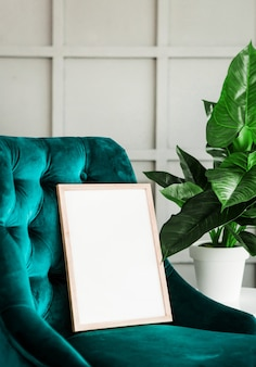 White poster frame mock green chair