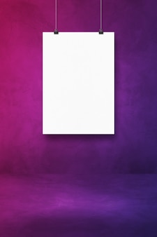 White poster hanging on a purple wall with clips. blank mockup template