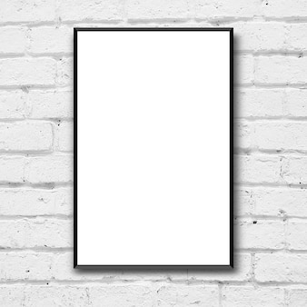 White poster with black frame on brick wall background