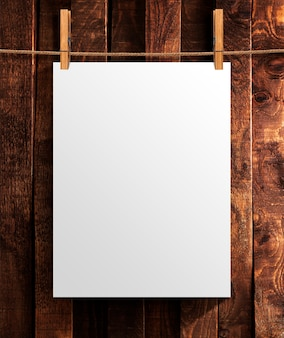 White poster on wooden background.