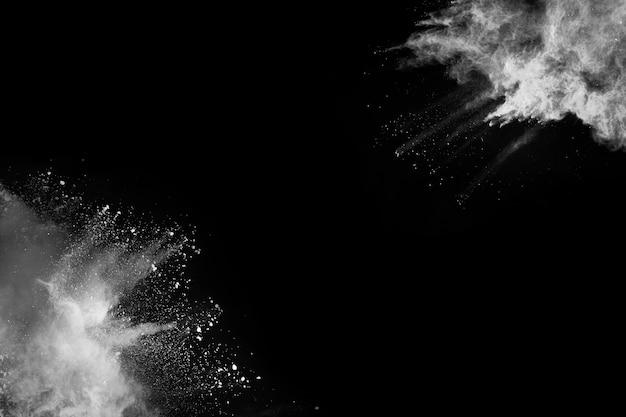 White powder explosion on black background.