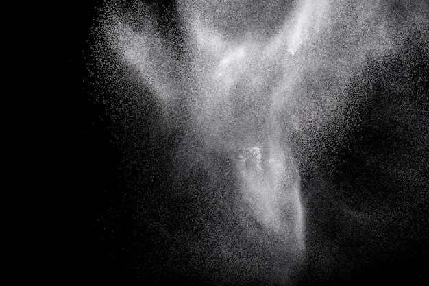 White powder explosion.freeze motion of white dust particles on black background.