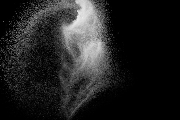 White powder explosion isolated on black background