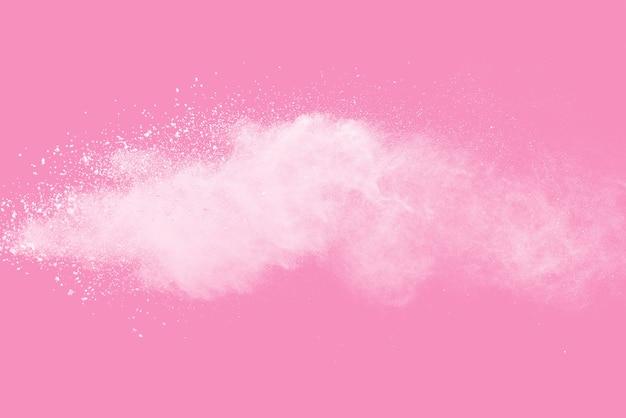 White powder explosion on pink background
