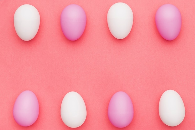 White and purple eggs on table