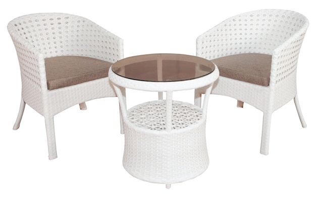 White rattan wicker furniture set consisting of two chairs and table with glass top. stylish outdoor or garden furniture.