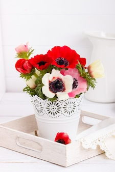 White and red anemone flowers