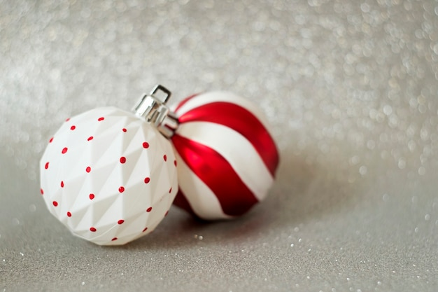White and red balls - tree decoration for new year on festive background