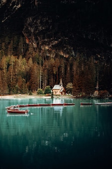 White and red boat on lake during daytime