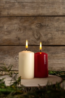 White and red candles over wood