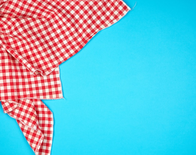 White red checkered kitchen towel on blue