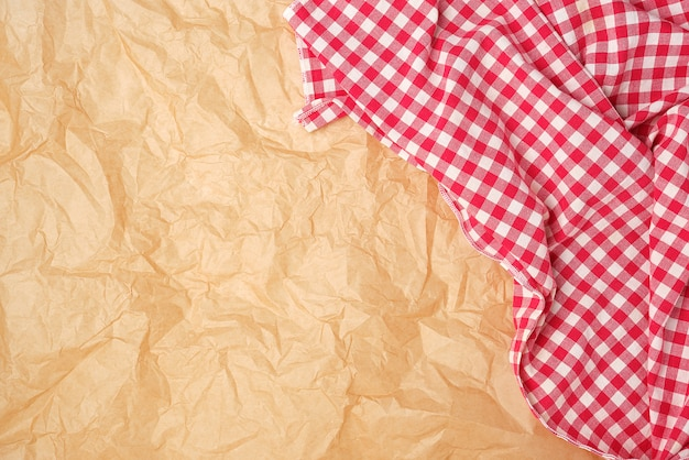 White red checkered kitchen towel on brown paper