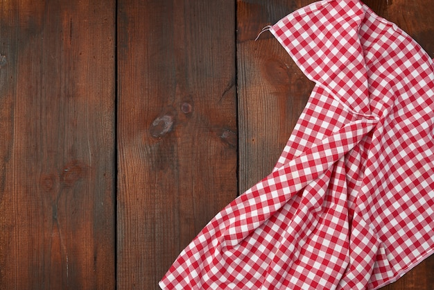 White red checkered kitchen towel on a brown wooden