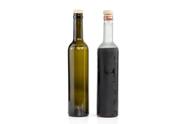White and red wine bottles isolated.