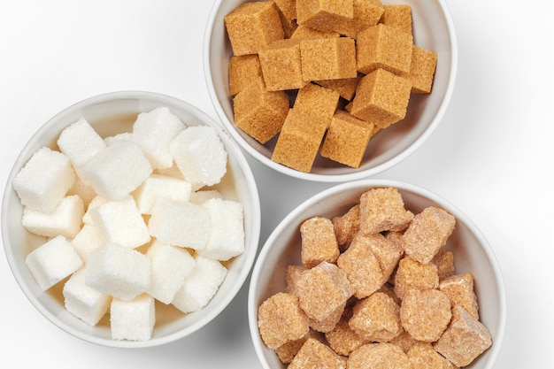 White refined sugar and brown unrefined sugar cubes