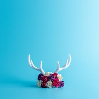 White reindeer antlers with rose flowers