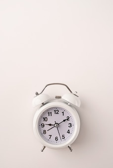 White retro alarm clock isolated on white background with copy space