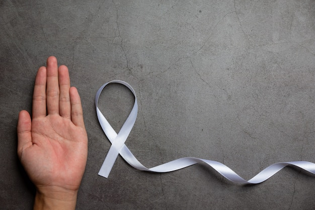 White ribbon symbol of peace international day of non violence.