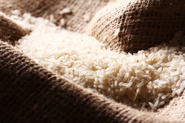 White rice grains on sack cloth