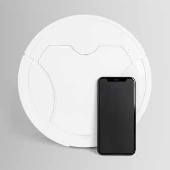White robot vacuum and smartphone home electronics