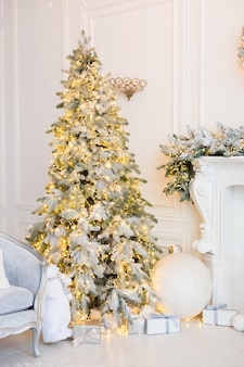 White room with christmas tree and garlands