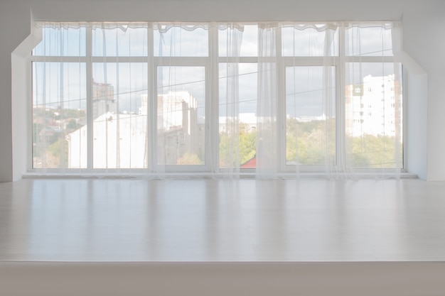 White room with large windows