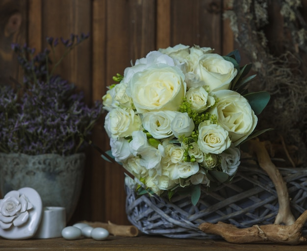 White rose bouquet on a rustic furniture