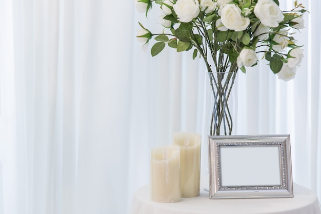 White rose with candle wedding beautiful photo frame love home decoration or wedding background