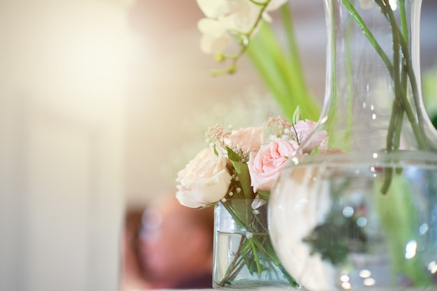 White roses in clear glass vases