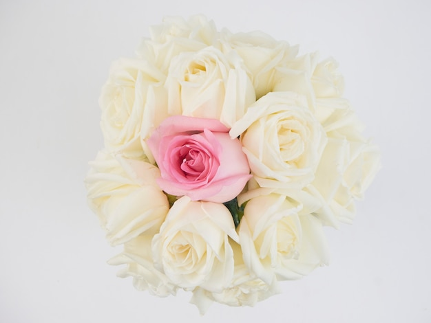 White roses flowers and one pink rose flower