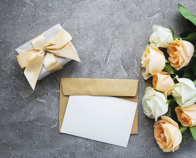 White roses and greeting card
