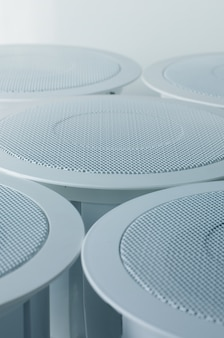 White round circle speakers near each over. alarm system. soft focus photo good for security service engineering company