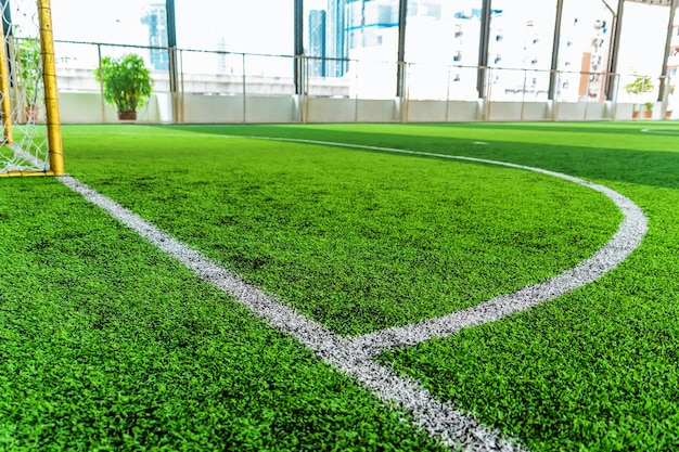 White round goal line on green grass for sport soccer field with nobody for background