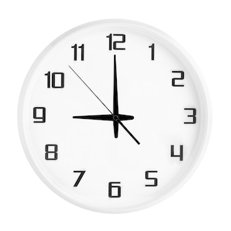 White round office clock showing nine o'clock isolated on white. blank white clock showing 9 pm or 9 am time