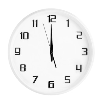 White round office clock showing twelve o'clock isolated on white.