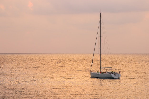 White sailboat of tourist with sunset sky on the ao thai sea area around haad bangbao.