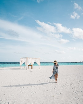 White sand beach in beautiful maldives with a lady alone