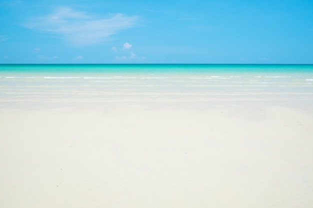 White sand beach, clear water and blue sky