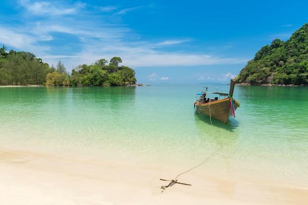 White sand beach and long-tail boat at kham-tok island (koh-kam-tok), province, thailand.