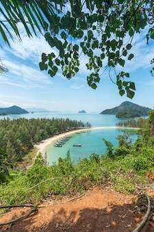 White sand beach and long-tail boat at kham-tok island (koh-kam-tok) ranong province, thai