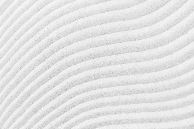 Fondo di struttura della superficie della sabbia bianca zen e concetto di pace