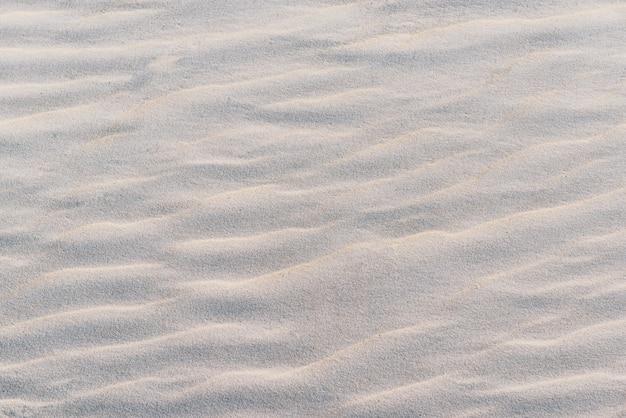 日没時の白い砂のテクスチャ