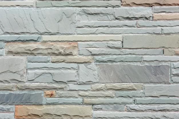 白い砂岩のレンガの壁のテクスチャ背景